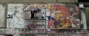 I lavori di restauro del murale